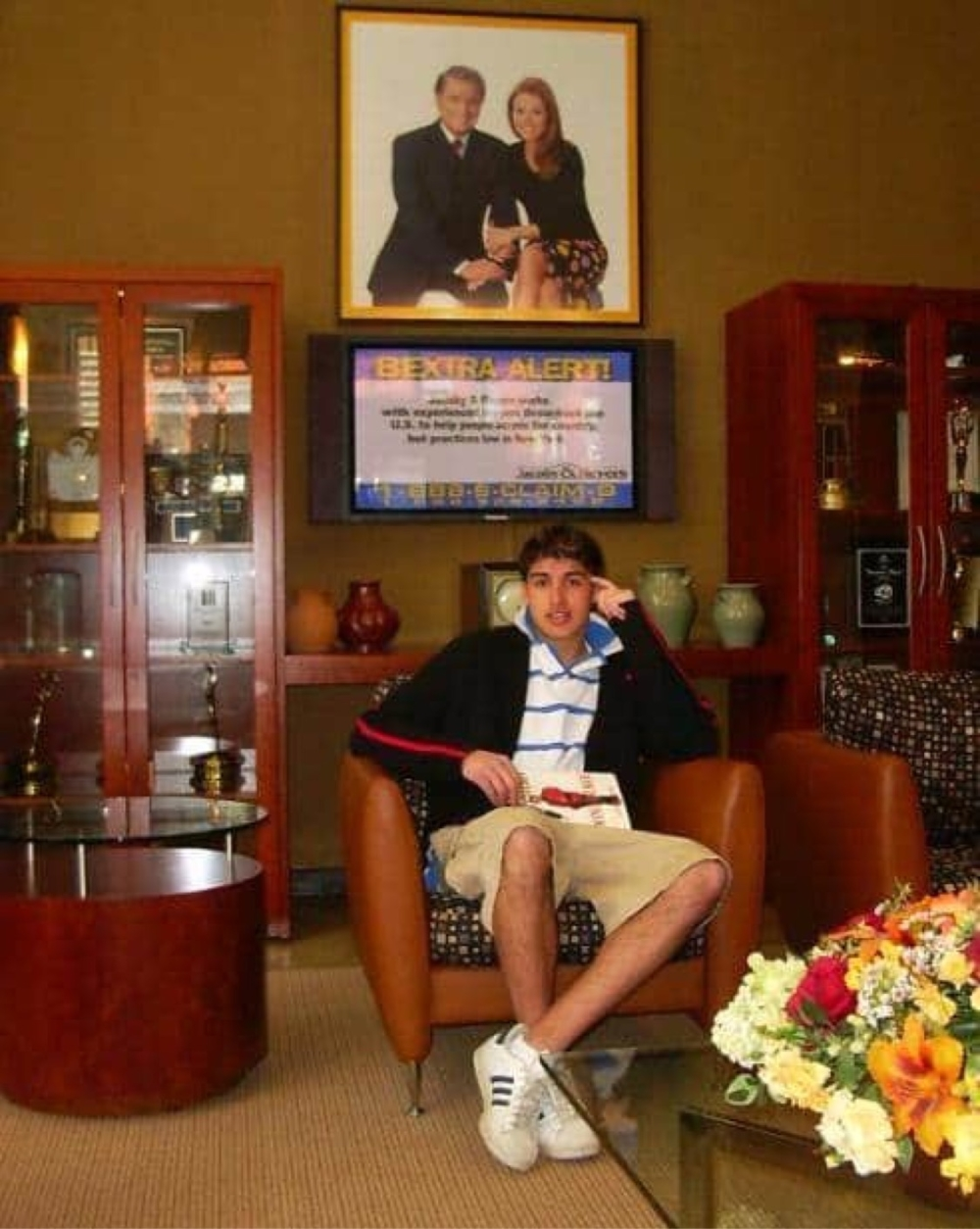 Chris Marine under portrait of Regis Philbin & Kelly Ripa