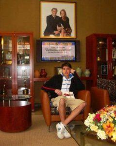 Chris Marine under portrait of Regis Philbin & Kelly Ripa