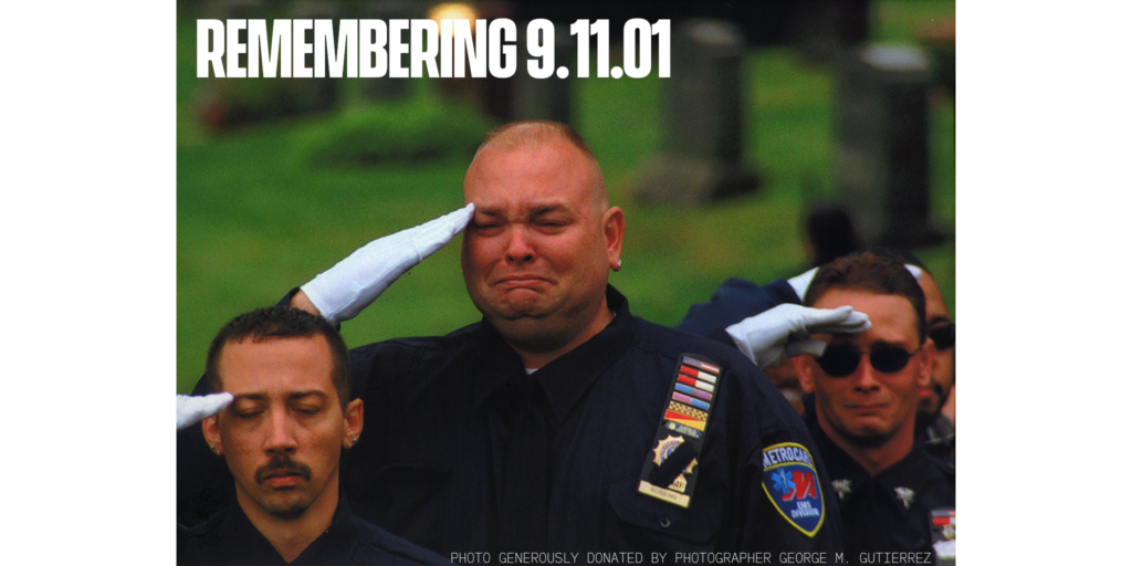 EMS workers salute fallen fire fighters and rescue workers from 9.11 attacks